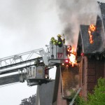 Firemen tackle a house fire